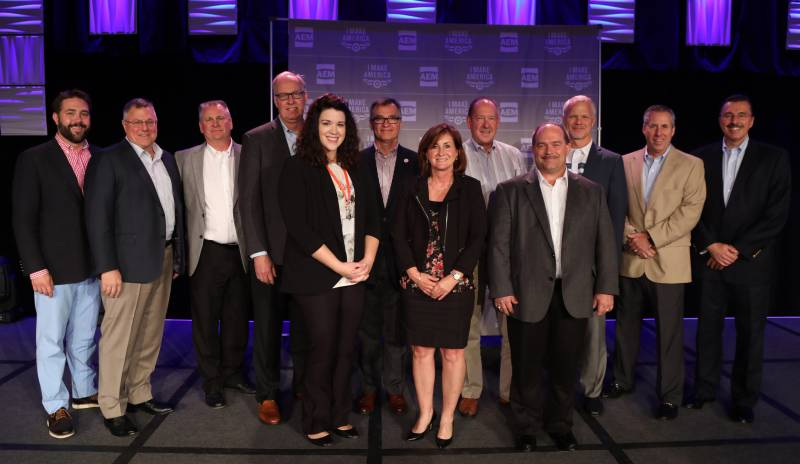Representatives from several of the 22 companies honored with AEM 2017 I Make America Gold Awards are pictured at the recent AEM Annual Conference with AEM President Dennis Slater (far right) and AEM Vice President Kip Eideberg (far left).